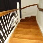 Eenkwart trap met gietijzeren spijlen