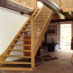 Trap met houten spijlen